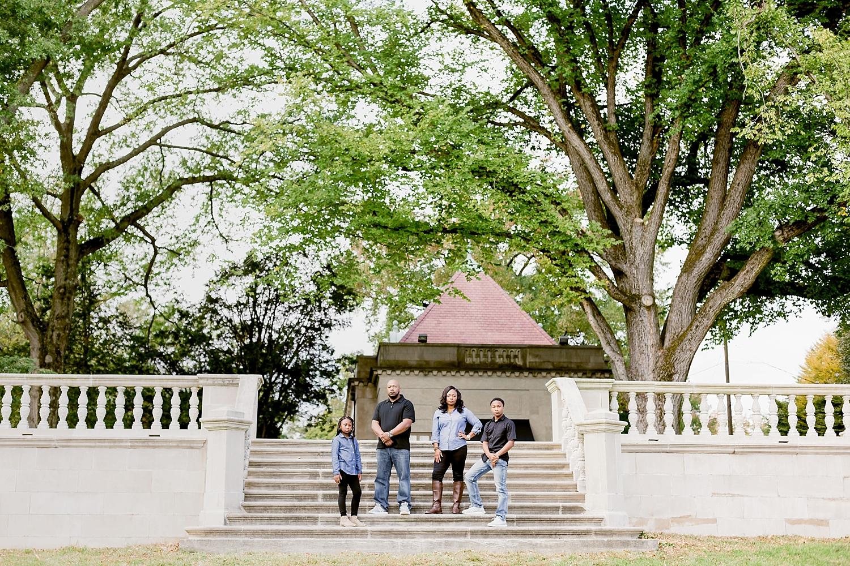 family of four posing on steps