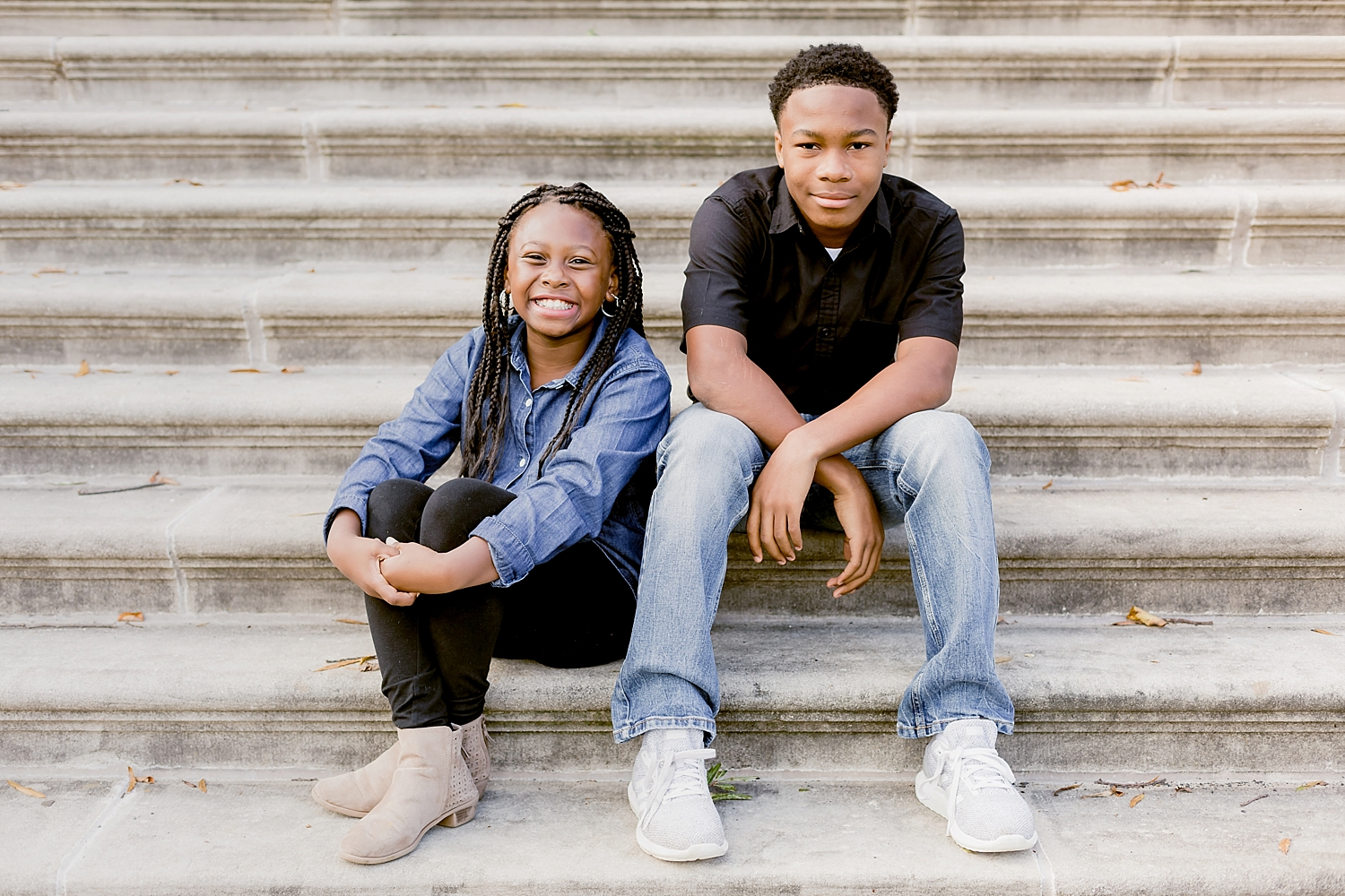 brother and sister sitting on steps in photography pose