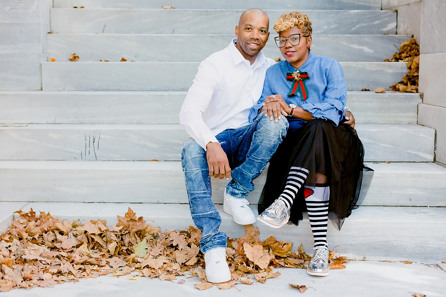 romantic married couple posing on the steps for family photo