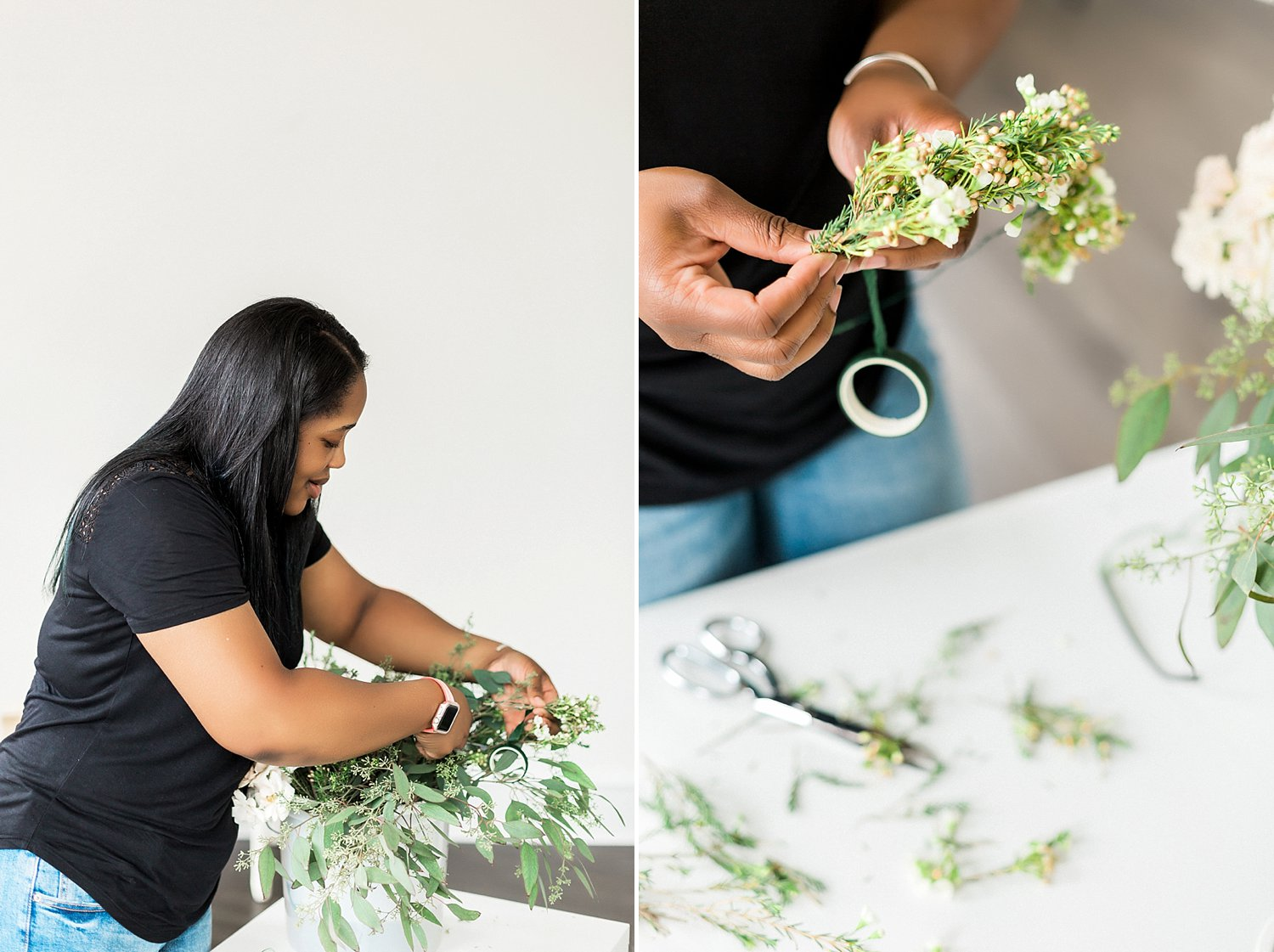 florist arranging flowers on a white table for personal branding photos with Ann Blake Photography