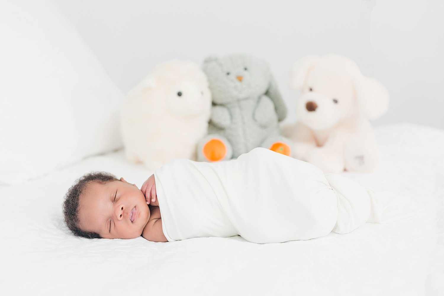 lifestyle newborn posing with props and white details
