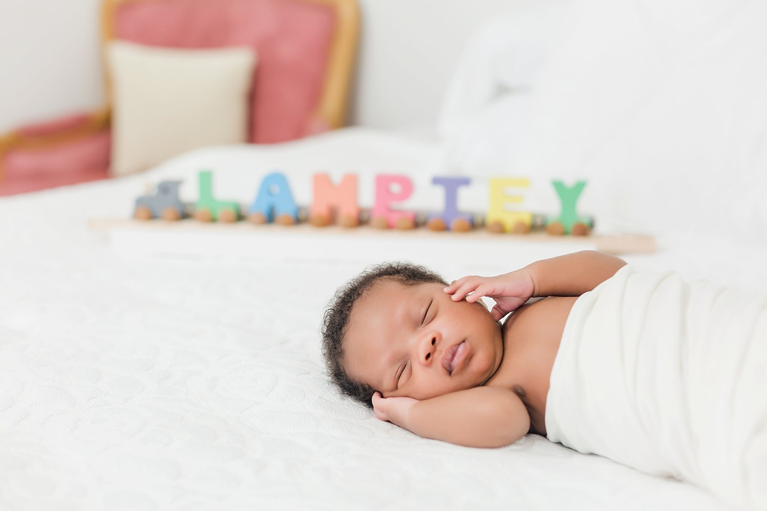 newborn portrait session with train prop that spells family name