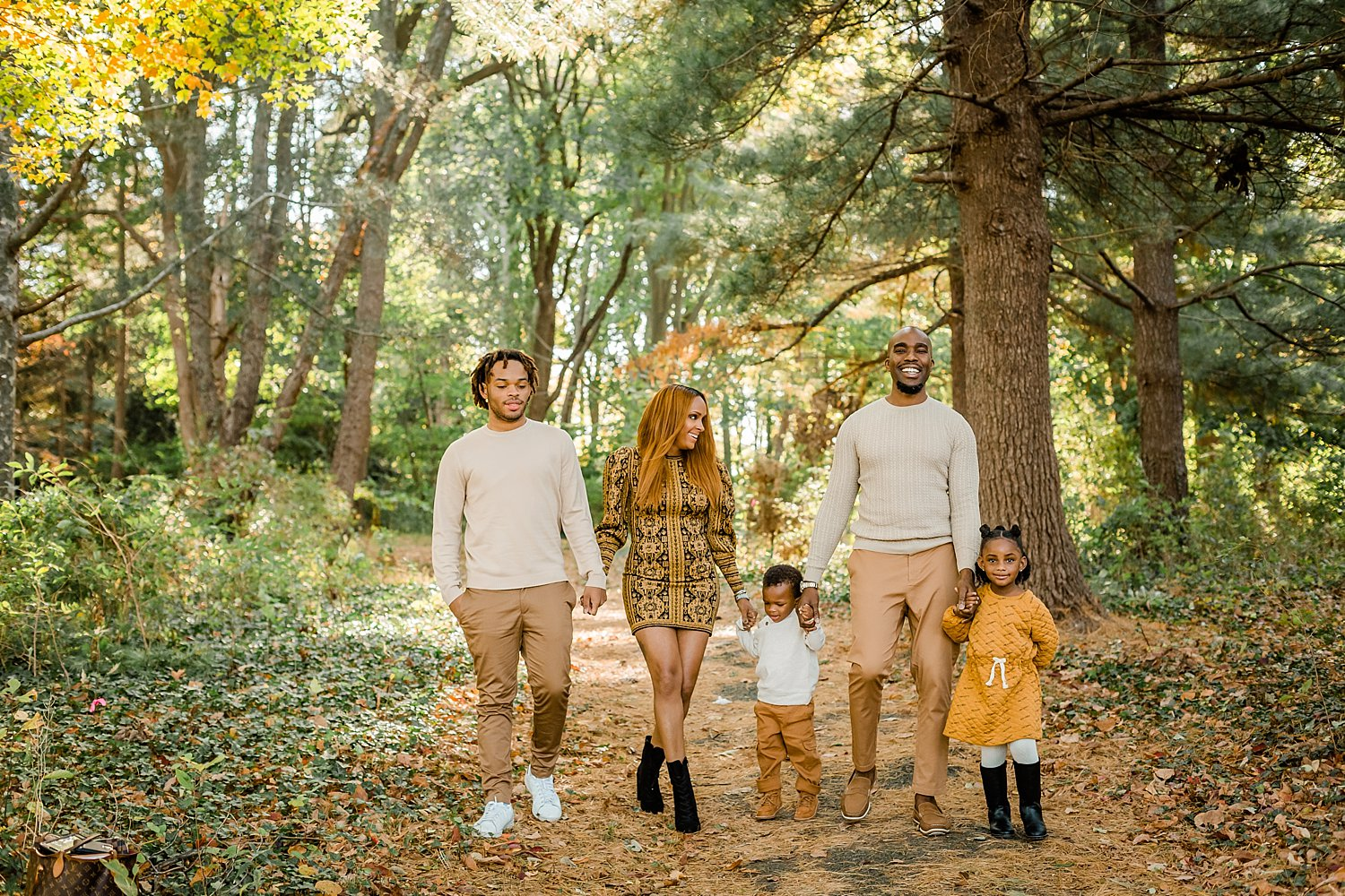 Family taking a casual walk through Awbury Arboretum in fall mini session