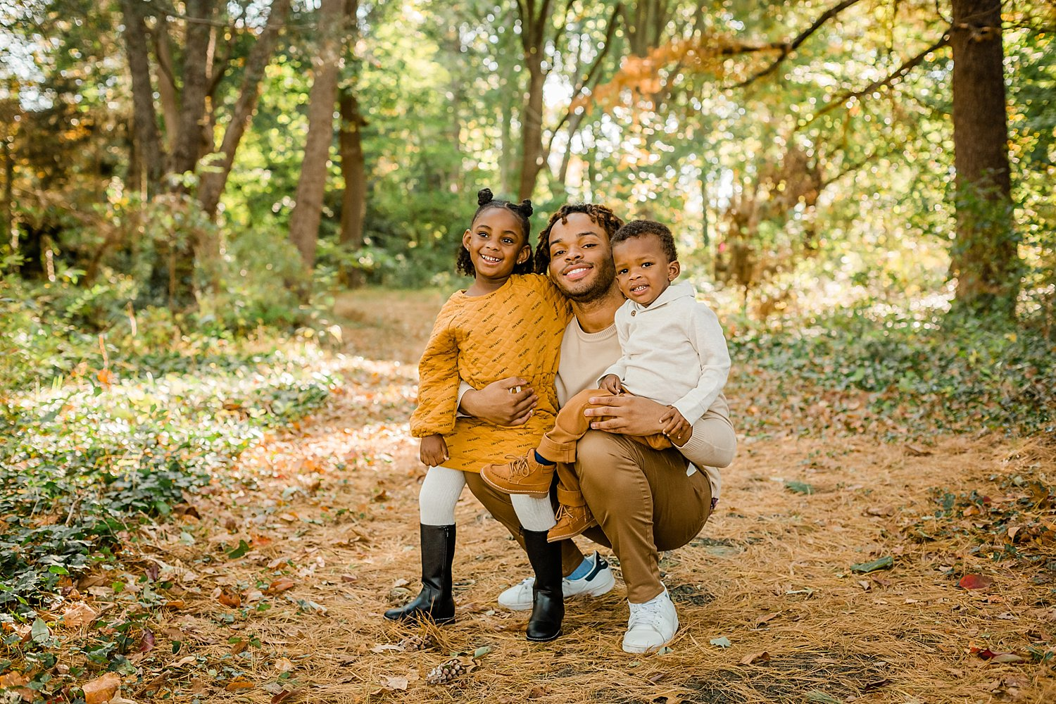 Siblings pose for a portrait at Awbury Arboretum
