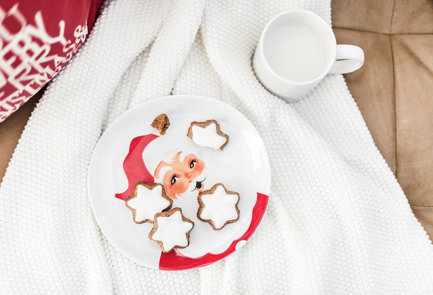 cookies and milk left for santa on a white blanket