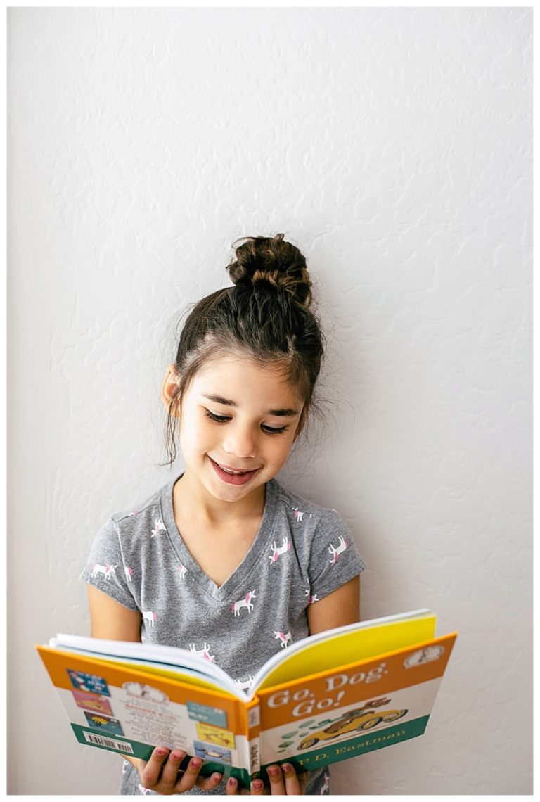 elementary scchool girl reading her very book