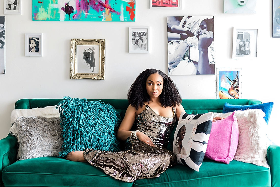 A beautiful woman smiles in a decorated room. Philadelphia photographer Ann Blake makes sure your personal branding session is fun and relaxed.