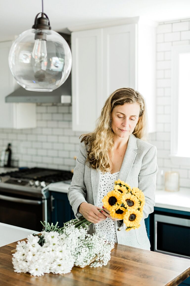 Realtor gets home ready for showings with fresh flowers